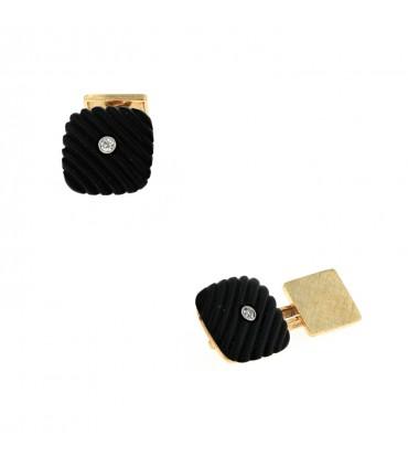 Gold and onyx cufflink
