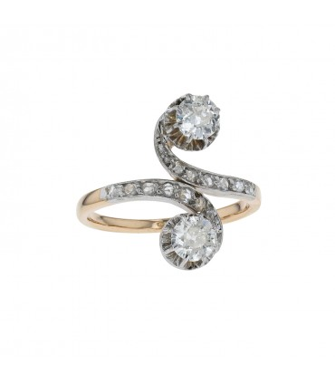 Diamonds, gold and platinum ring