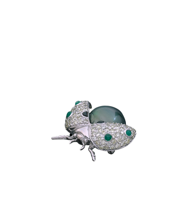 Cultured pearl, emeralds, onyx, diamonds and gold brooch